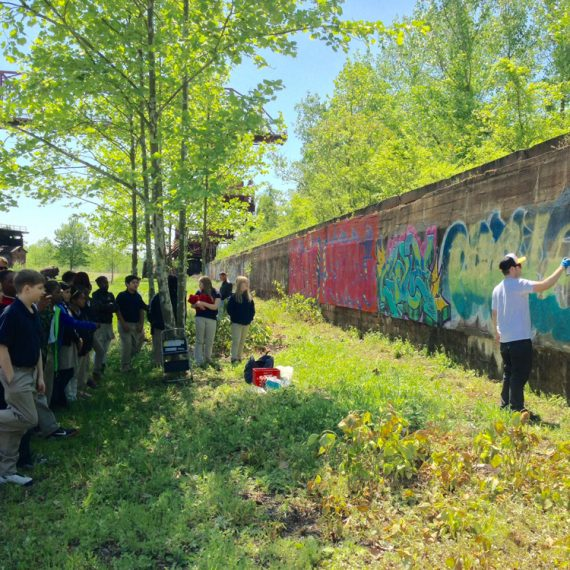 Painting demonstration for school students on an Urban Art Tour